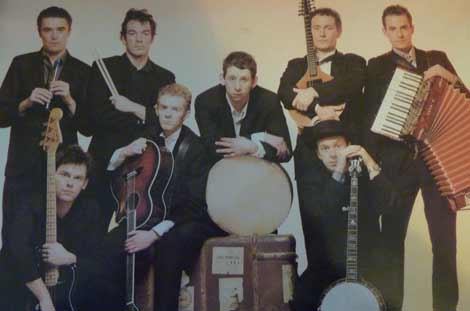 The Pogues combine traditional Irish music with the spirit of punk rock