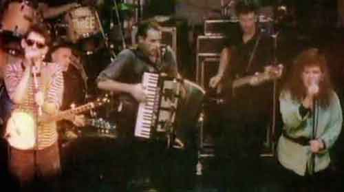 Kirsty on stage with The Pogues