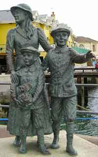 Statue of Annie Moore and her brothers _photo Bkkbrad CC3