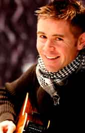 Neil Byrne singer songwriter of Irish group Celtic Thunder